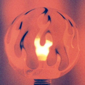 Three Color Flame: Red Flame on Ivory at Night